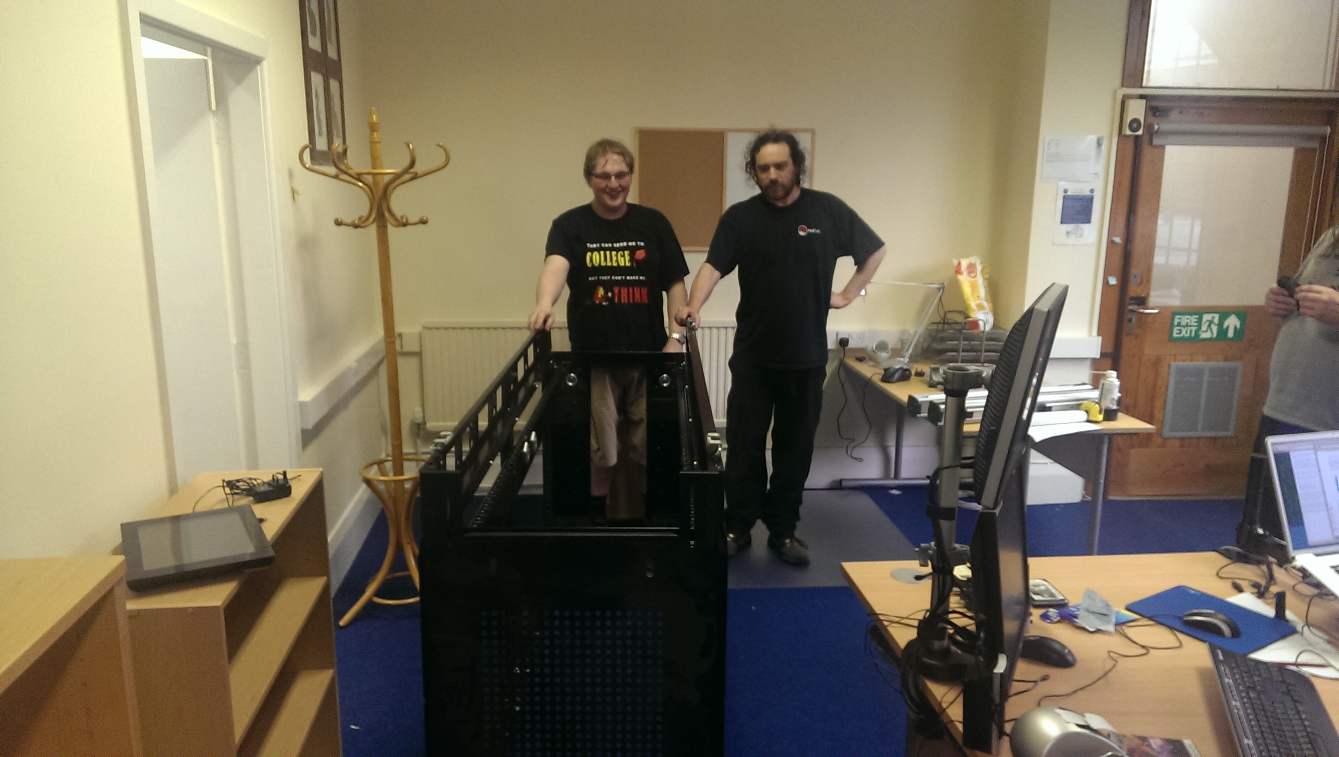 Ian and Tom moving the larger rack (Darth Vader's Coffin)