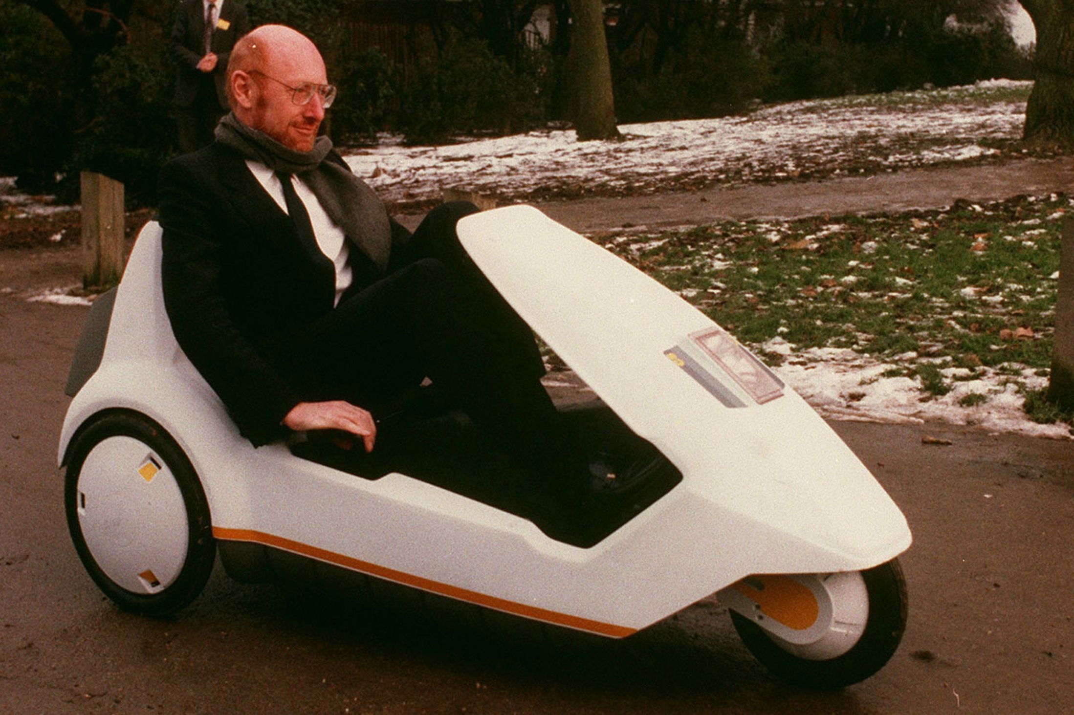 The Sinclair C5 with Clive Sinclair sat inside, the last nail in the coffin for Sinclair as a company
